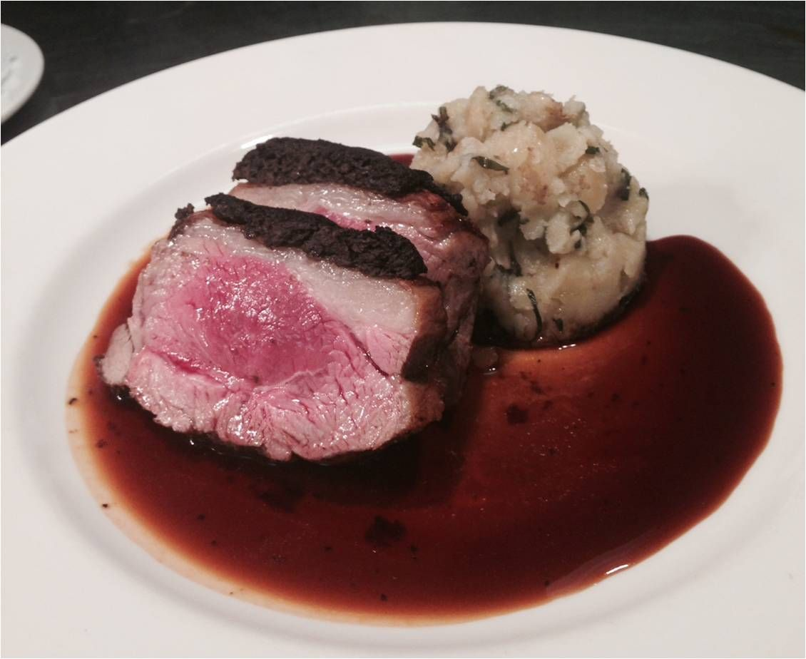 Roast Lamb Rump, Black Olive Crust, Crushed Minted Jersey Royals with a Thyme and Rosemary Jus
