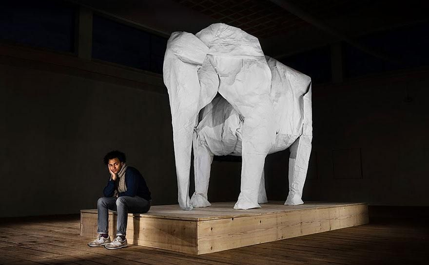 """The next time you idly fold a paper airplane - think about this: artist Sipho Mabona made a life-size elephant from a single piece of paper. Of course, the paper wasn't just any old 8.5 by 11 inch notebook paper, it was a massive sheet that measured 50 x 50 feet.  The """"White Elephant&q"""