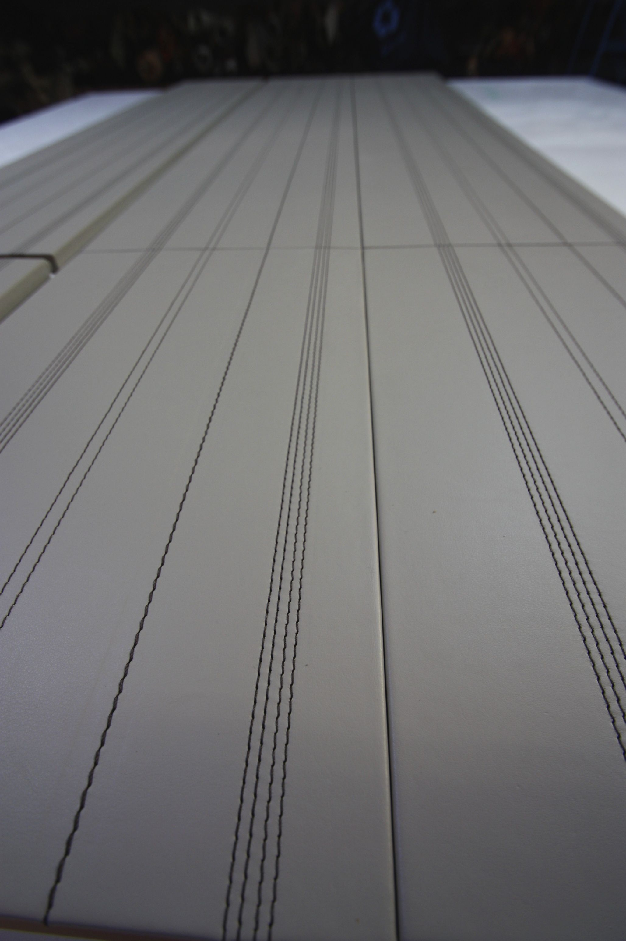 Harcourt London - Multiple Stitch line detail on leather wall panels