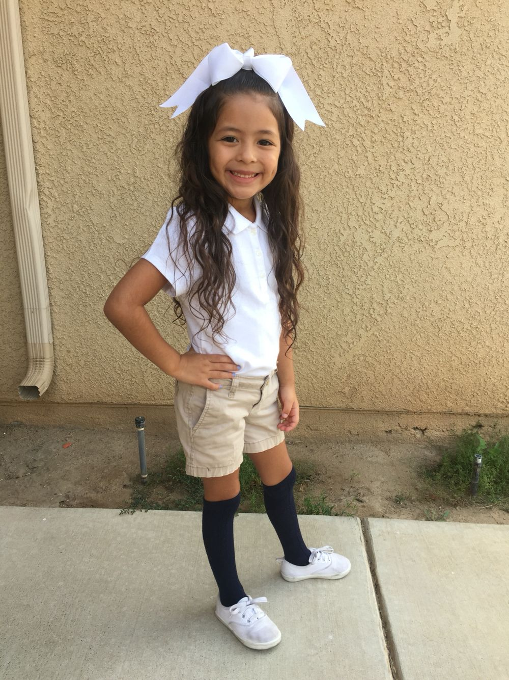 0c0a3e3afde Little girl school uniform White polo + high knee socks from Children s  place and khaki shorts from Walmart.