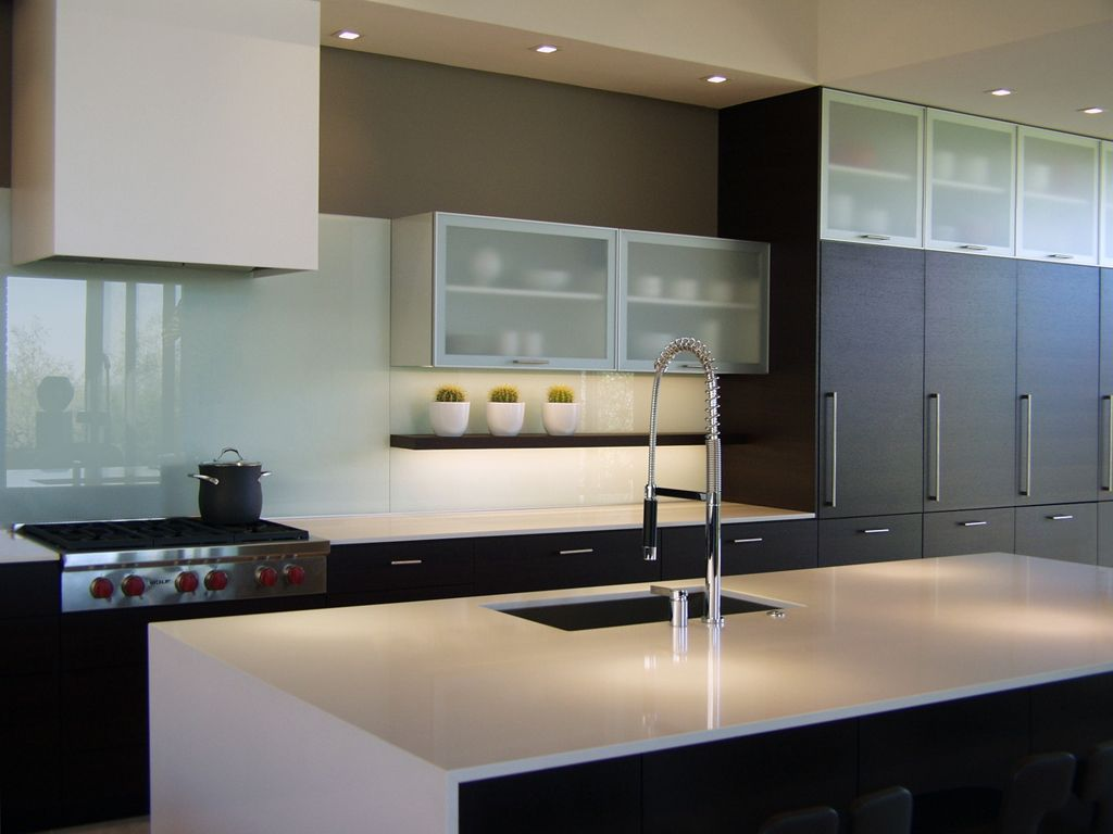 Modern Desert Home Kitchen With Back Painted Glass Wall