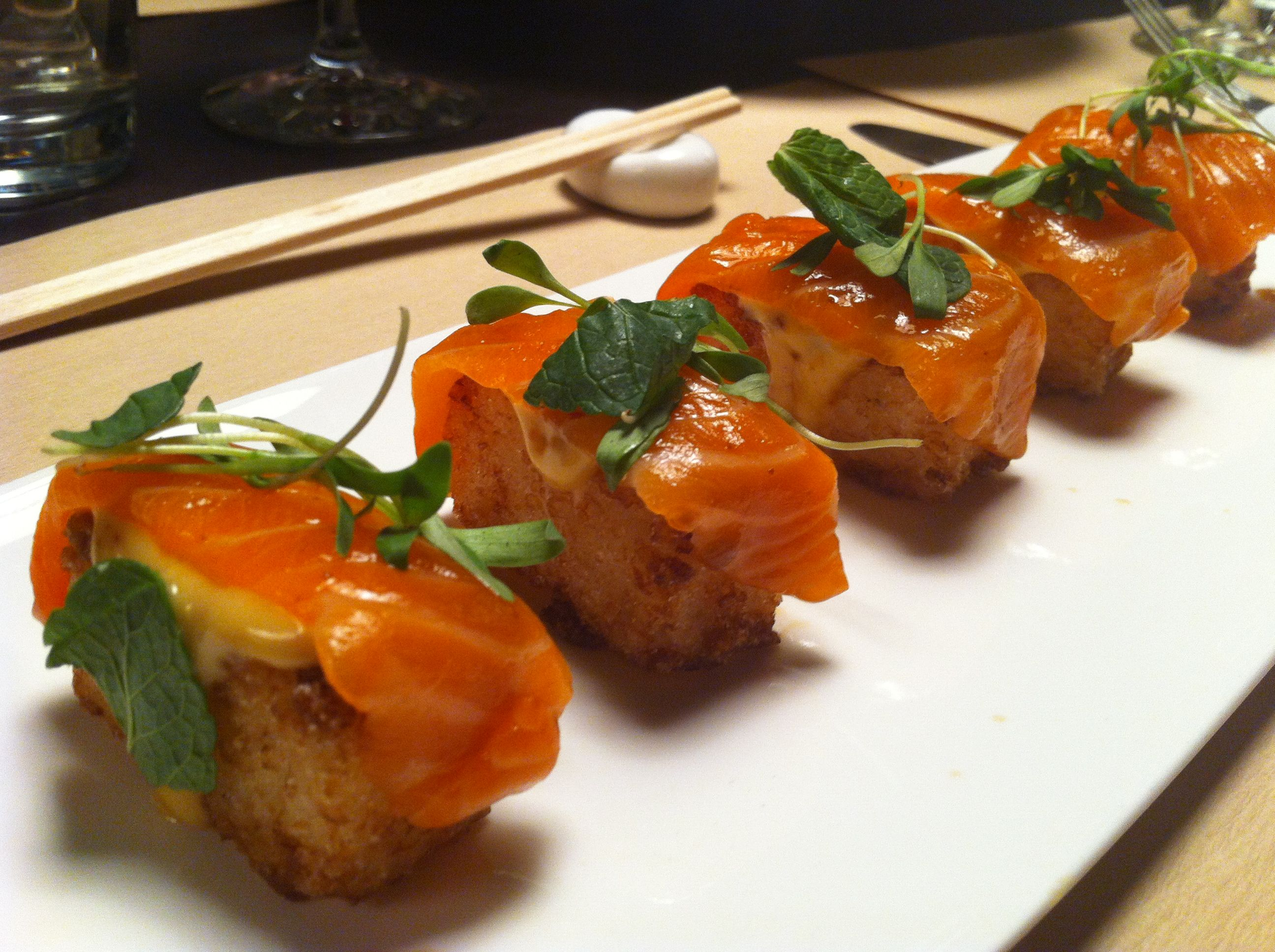Fresh salmon over crispy sushi rice with a chipotle mayo