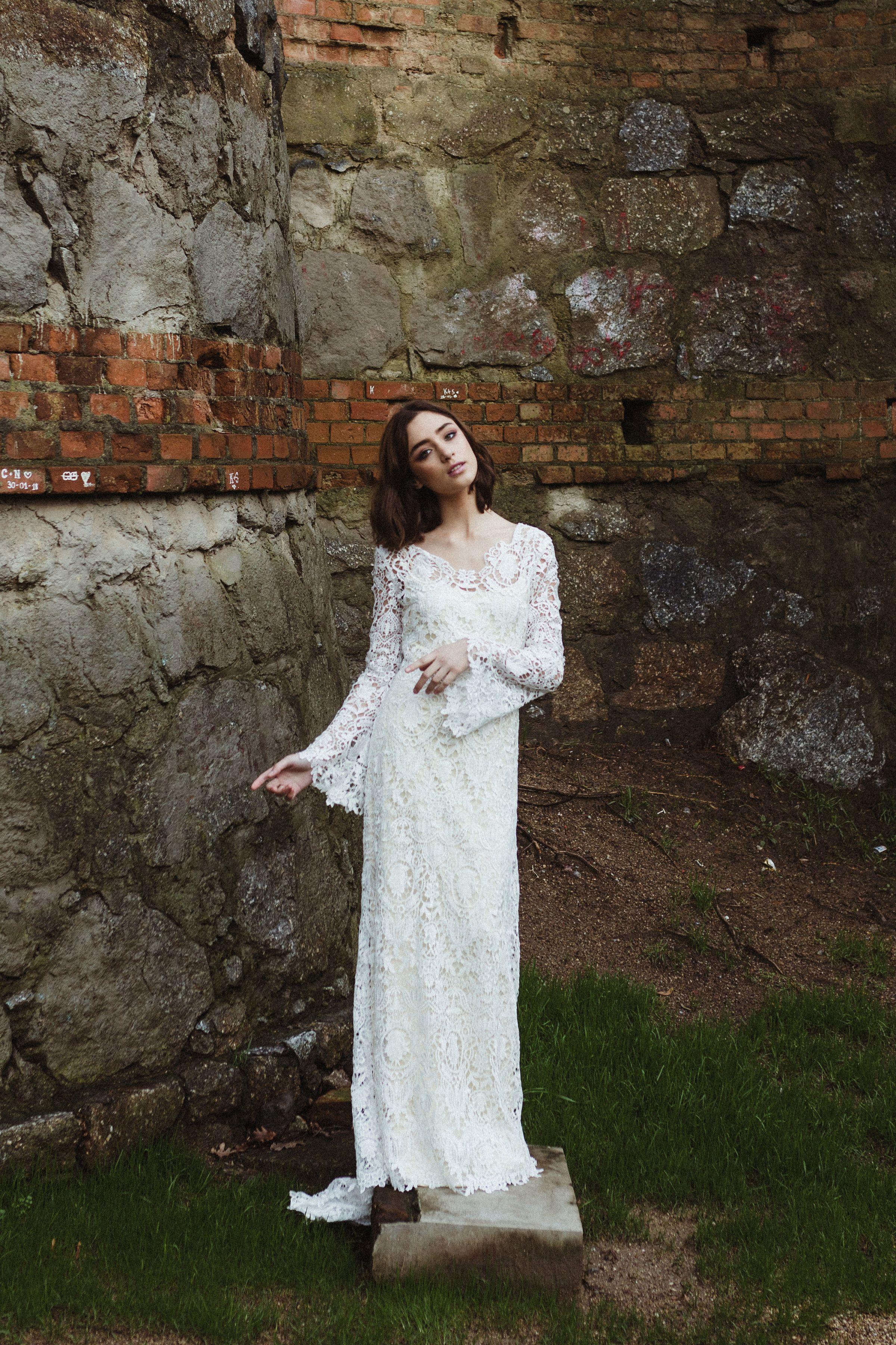 Modest long sleeve lace wedding dresses  Aquarius gown by Elizabeth Cooper Design  Photo by Ricardo Quintana
