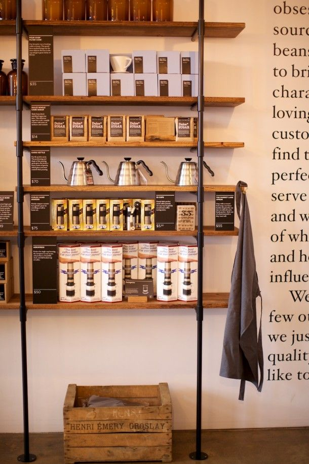 Awesome coffee merchandising cool rustic urban shelves for Coffee shop display ideas