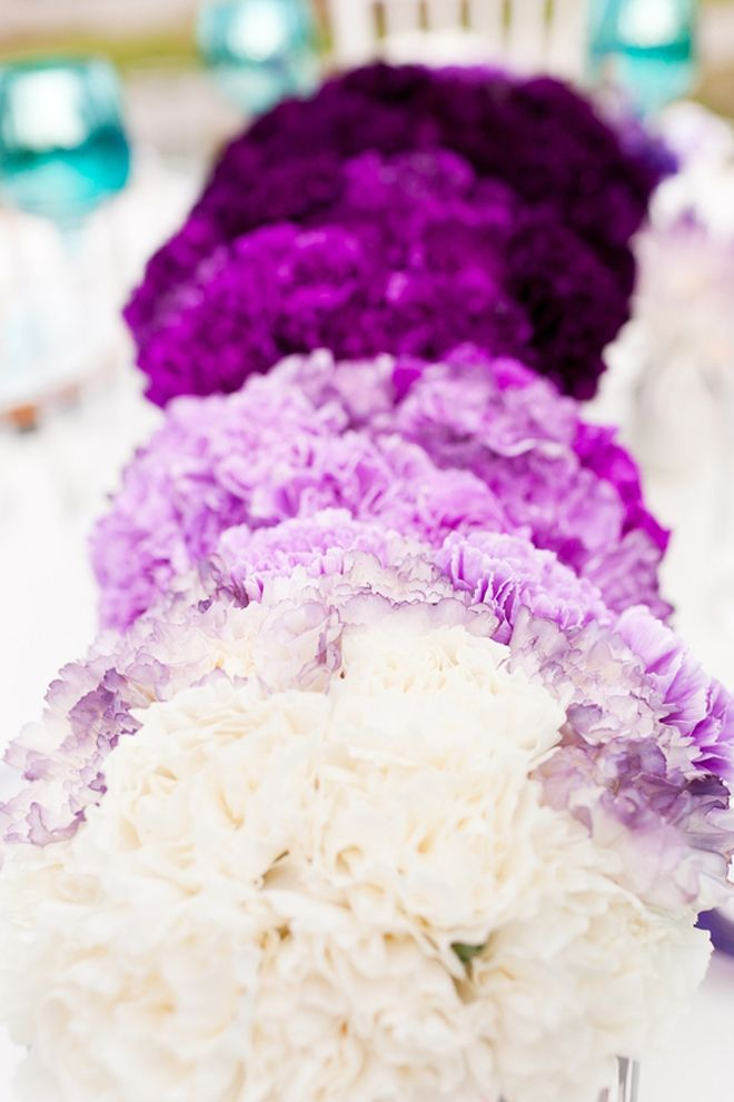 bridesmaids each carry different shades of the same color flowers