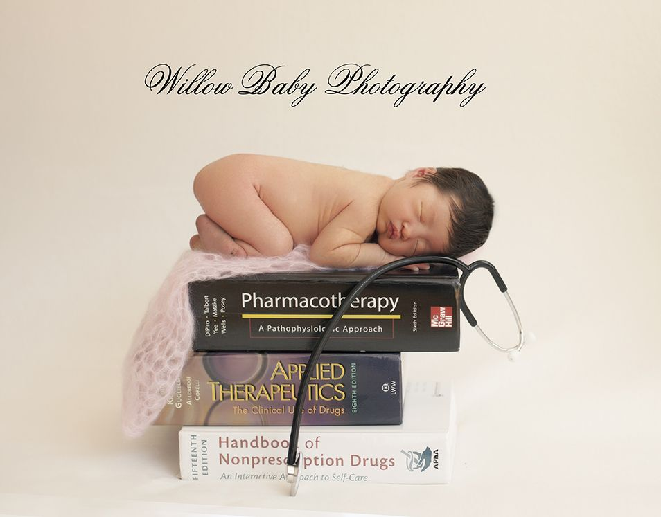 Newborn photography baby doctor picture with baby on stack of medical books newborn photos