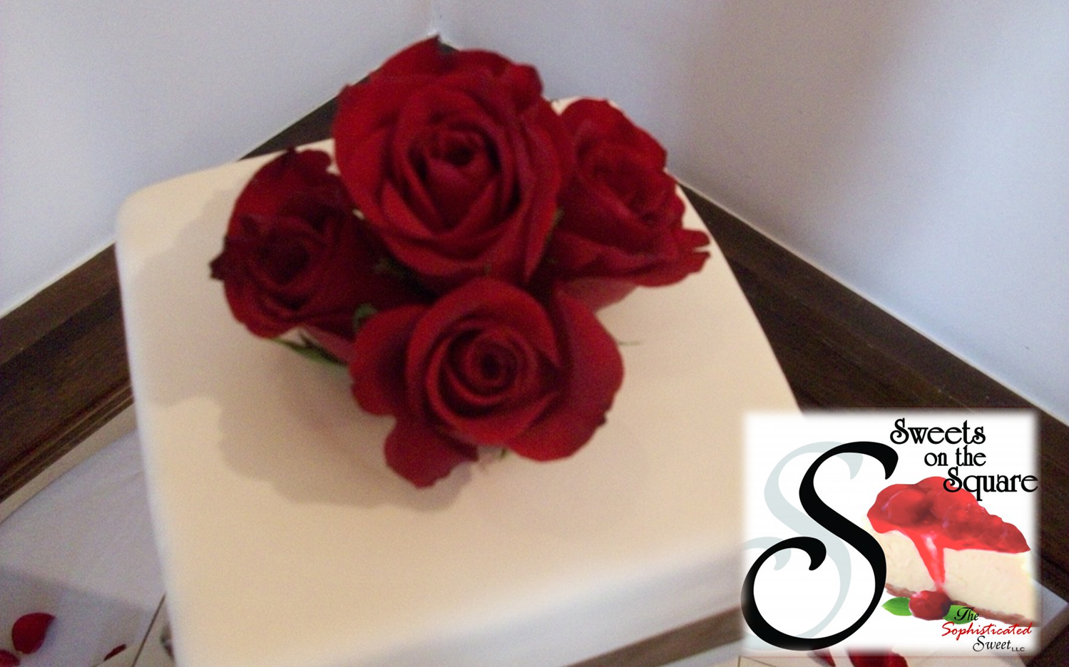 Classic white wedding cake topped with roses. Made from scratch just like everything else! - Sweets on the Square in Lawrenceville, GA