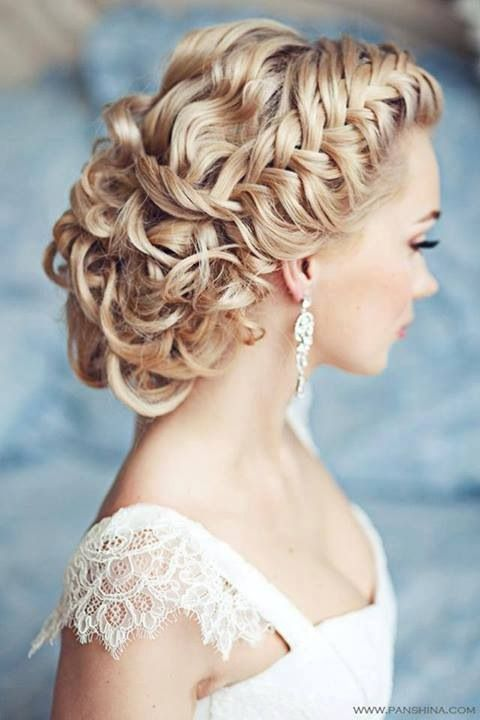Beautiful loose fishtail braid slicked back into a curly loose bun.