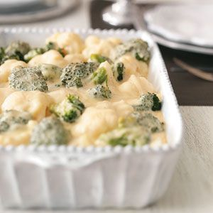 Broccoli-Cauliflower Cheese Bake Recipe -Creamy mozzarella and Swiss cheeses create the base for these tasty veggies, while a hint of cayenne pepper gives them a kick guests will adore. —Jenn Tidwell, Fair Oaks, California