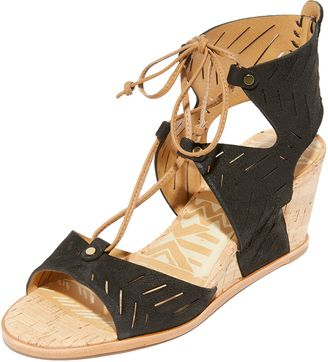 1e6e5d3e62c A simple cutwork design adds a graphic touch to these nubuck Dolce Vita  sandals.