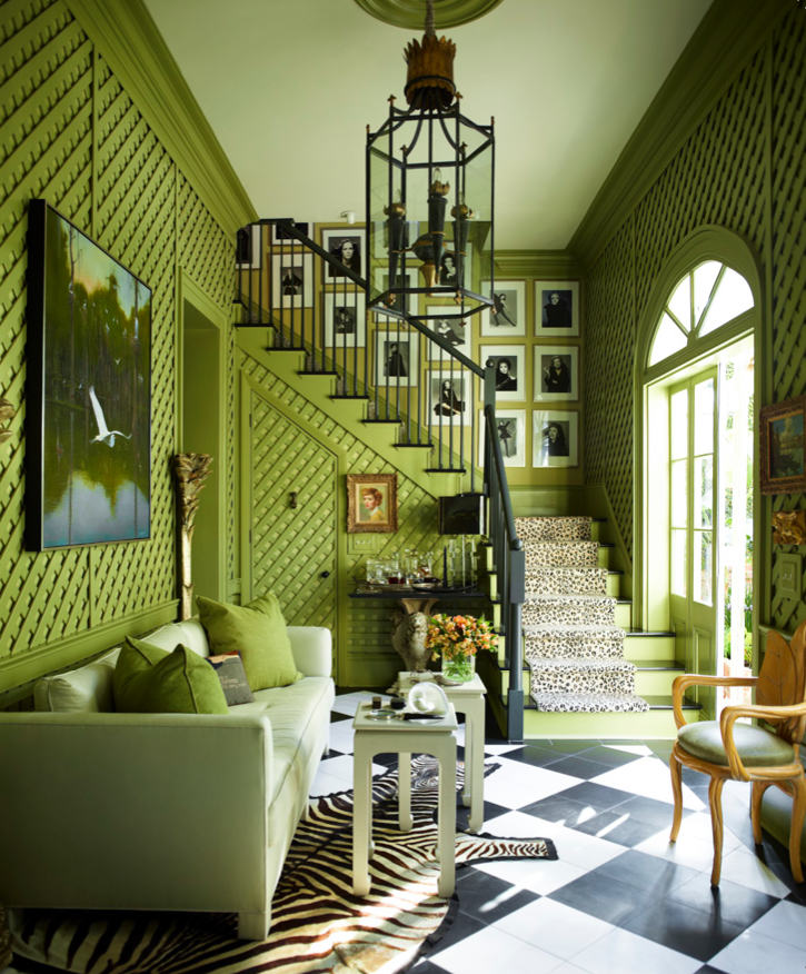 A zebra hide and a Somali Panther cut-pile runner take the black and white accents in Peter Rogers's apple green entry hall, designed by Rogers and Carl Palasota, in an exotic direction.