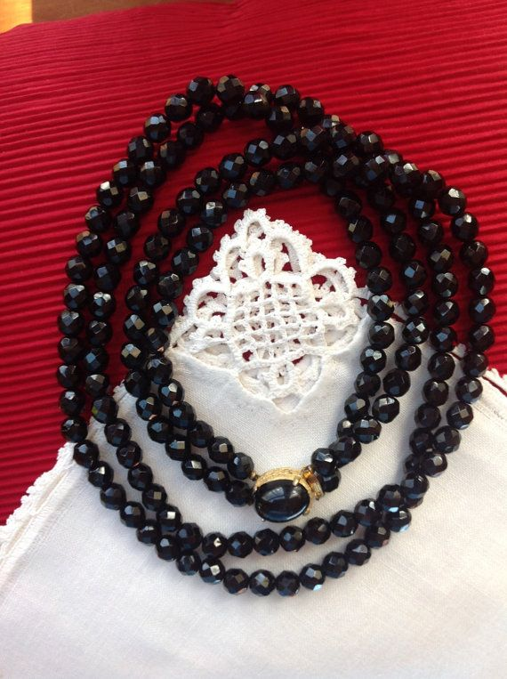 Listed is a classic black double strand necklace. Back beads of this type and quality are rare.  I will be happy to gift wrap your your