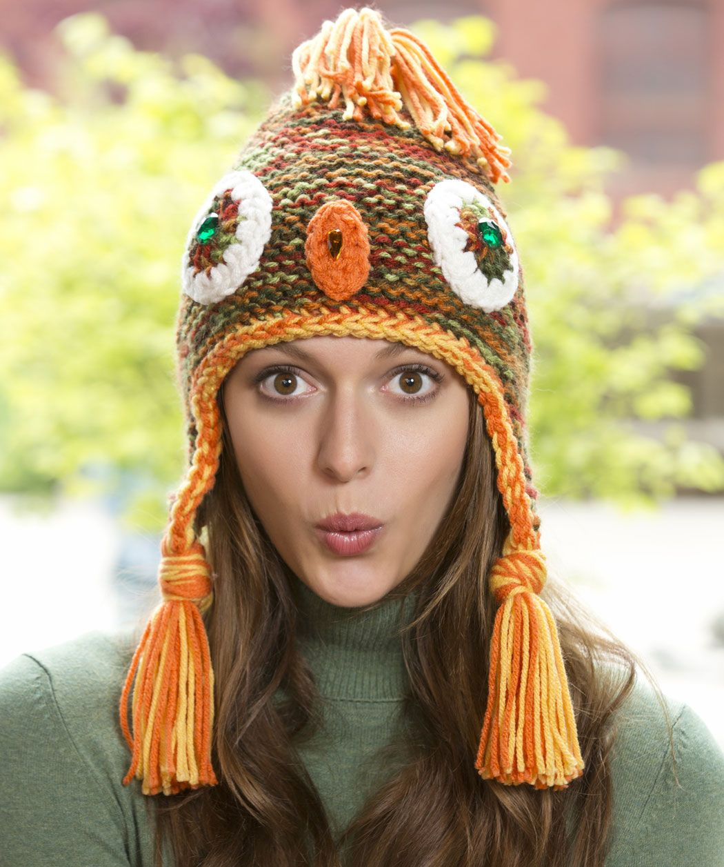 Perfect for owlish people that like to have fun! This knit hat is worked in rounds with two strands of yarn then edging, eyes and beak are crocheted.