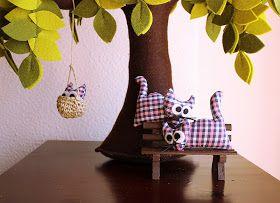 Cats under the felt tree