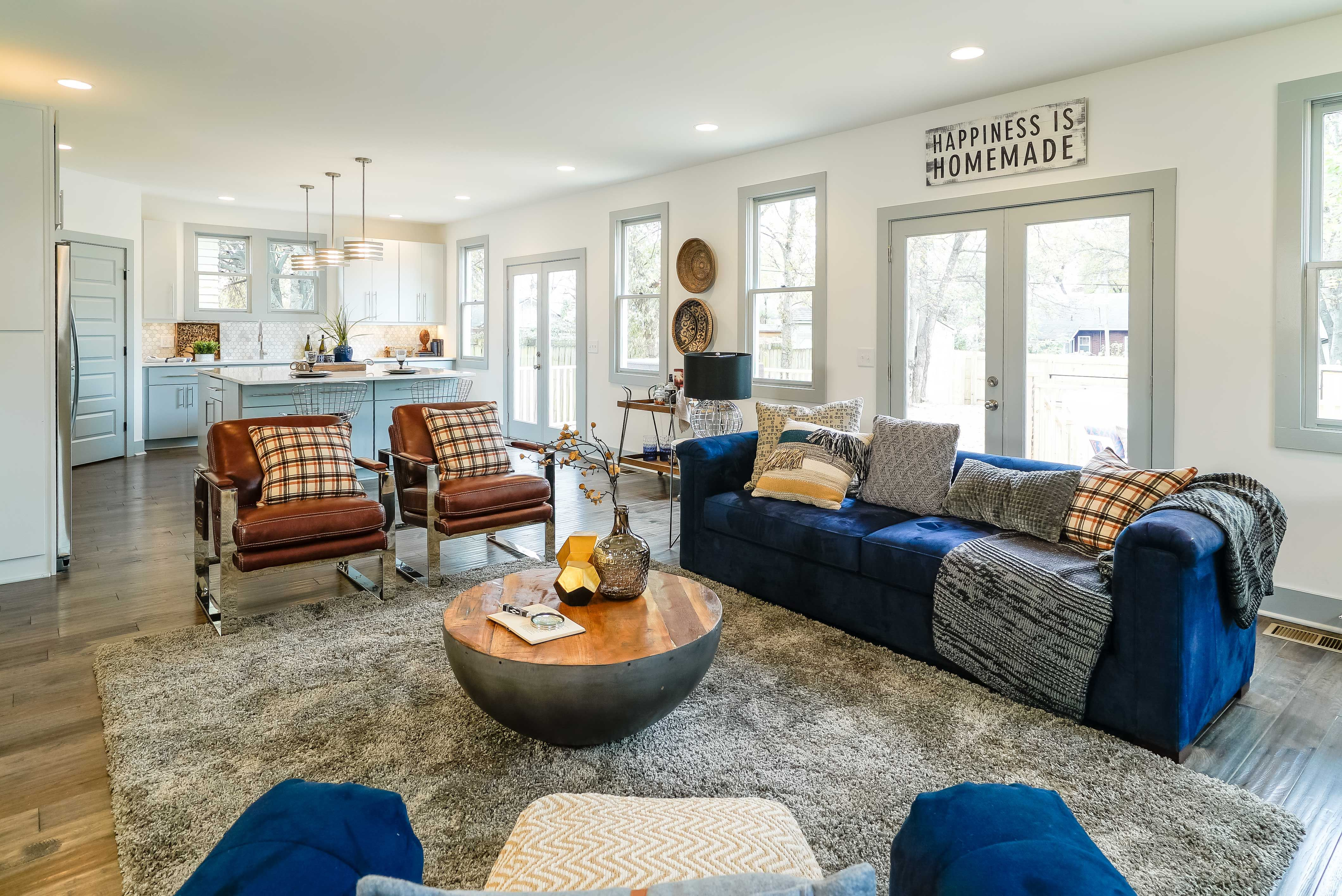 This Gorgeous Open Concept Home Features A Genius Guest Suite Open Concept Home Masters Of Flip Leather Chair Living Room