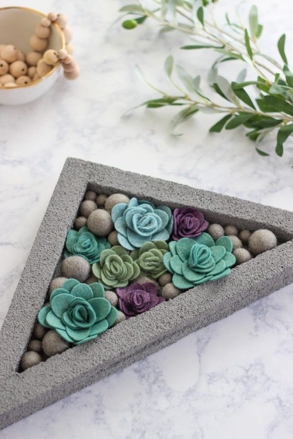 DIY Faux Concrete and Felt Succulent Planter is an inexpensive home decor craft that will fill your home with color and a modern flair.