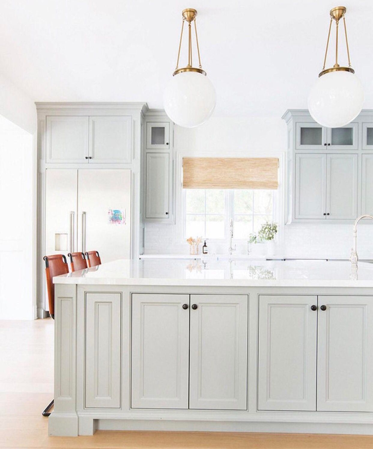 grey cabinetry contrasted with the burnt orange island stools rh pinterest co uk