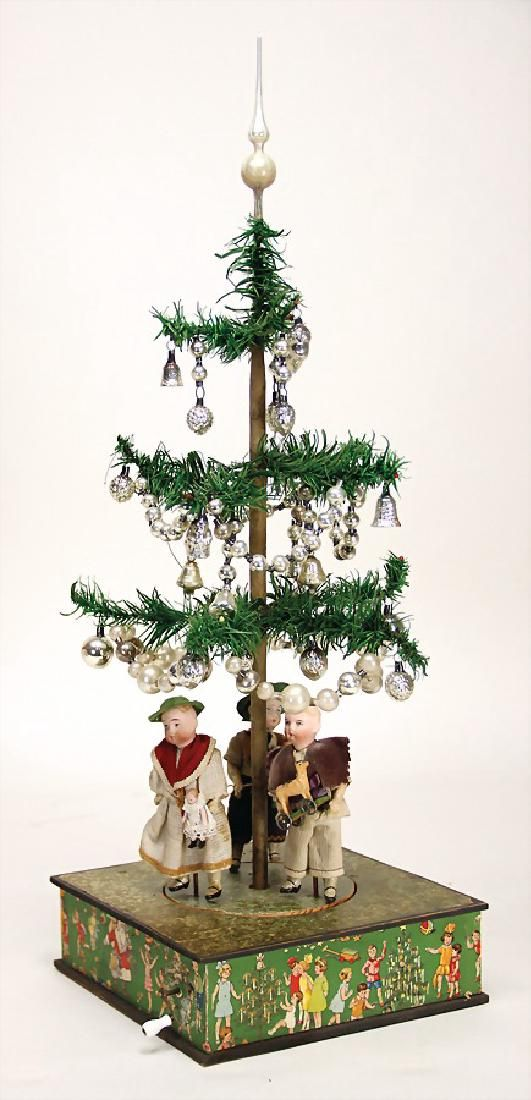 Antique Feather Tree on a Musical Tree Stand. When the music plays the doll  figures move in a dance. - Unusual Christmas Tree Machine, Machine With Crank With On Antique