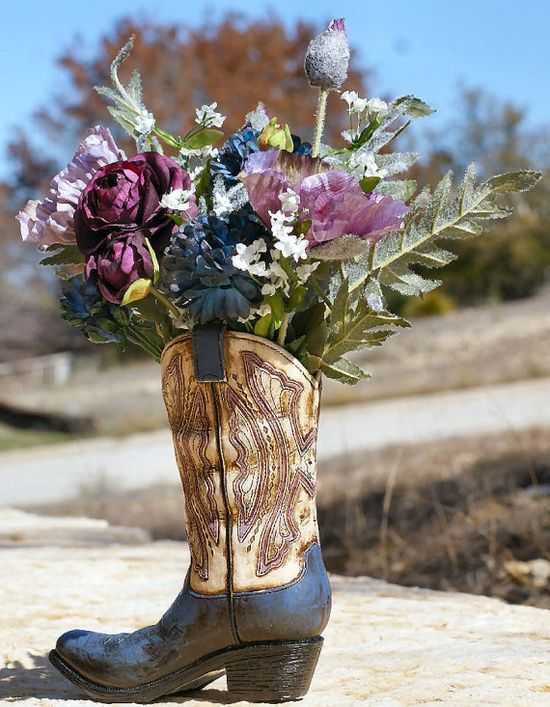 cowboy boot vase wedding decorations boots with flowers as a vase wedding ideas 3149