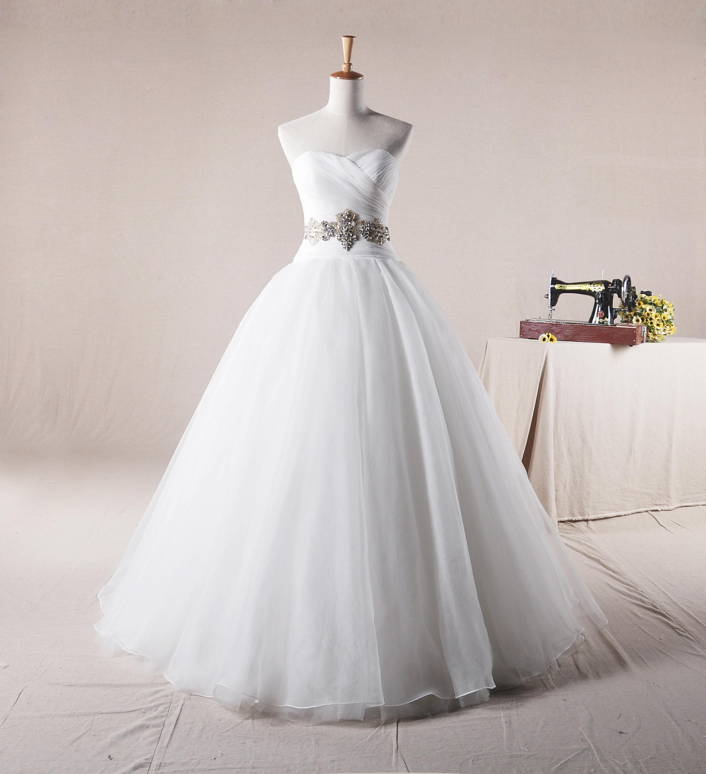 Sweetheart ball gown net wedding dress if the jeweled part was
