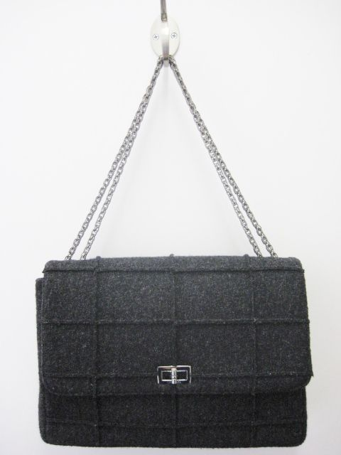 9d1265866cd9 Chanel jumbo flap bag. Charcoal grey wool bag in a square quilted pattern  with raw edges facing outward. Features pewter mademoiselle turn lock  closure with ...