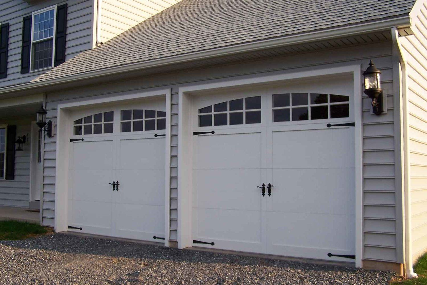 Add Some Pizazz To Your Garage Door With Windows And Decorative Handles Call Champion Garage Doo Garage Doors Garage Door Windows White Garage Doors