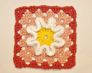 This square is done in 6 rounds making 5 rows. There's pictures for every step of the way. It's called the squiggly ruffle flower granny square pattern because of it's appearance with the ruffles. With the right colors it can look very spring like. This can be done in any colors you like of course. I've done a solid colored center and it looked just as great. Have fun crocheting this square and please do share any projects made from it.