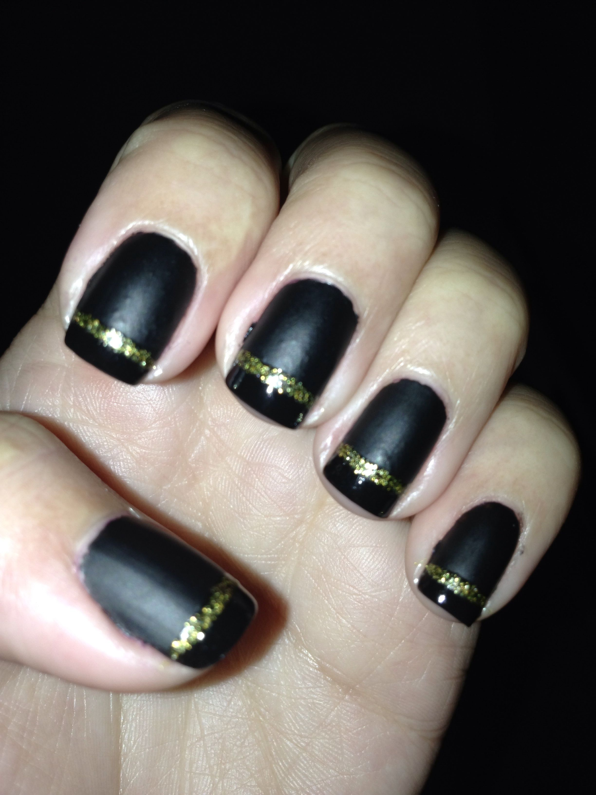 Black Matte French nail design with gold glitter line for the fall ...