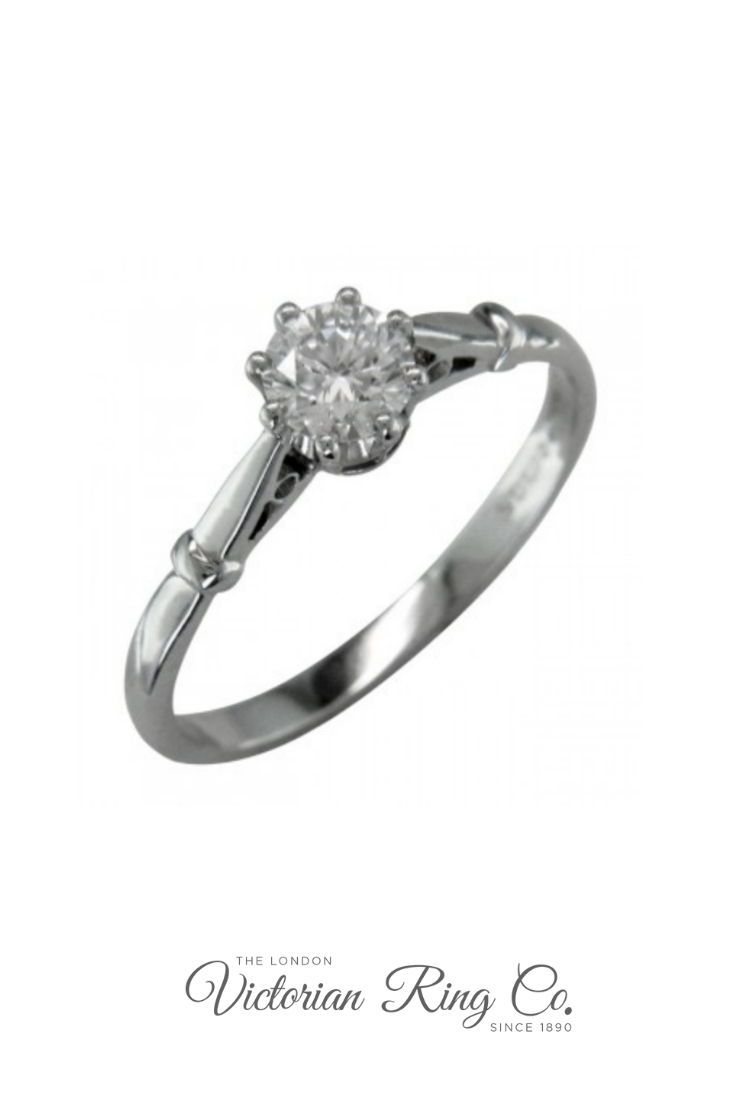 Elegant edwardian style engagement ring with slim band in white gold