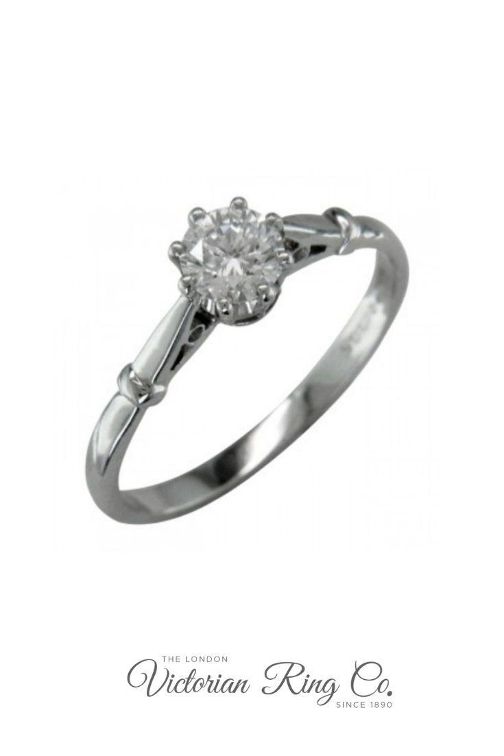 Elegant edwardian style engagement ring with slim band in white gold