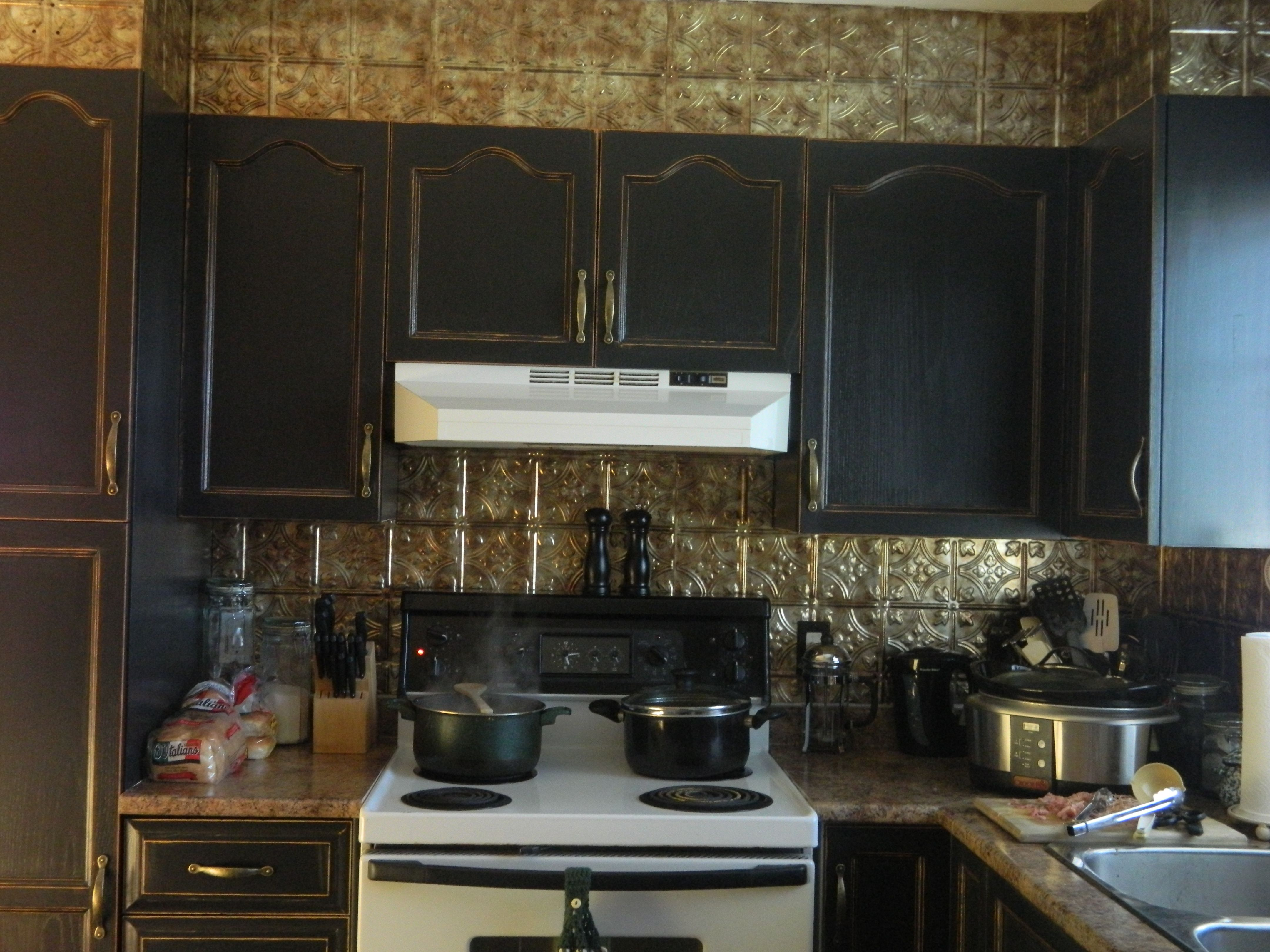 I recently painted my kitchen cupboards. They were oak and ...