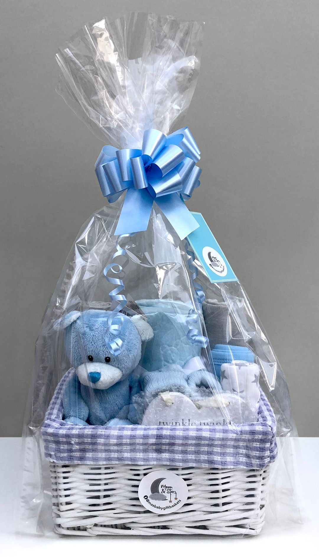 All of our blue baby boy gift baskets are presented in