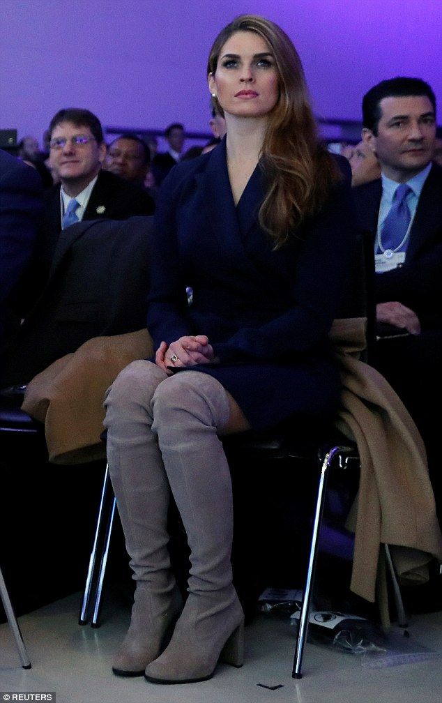 She loves her boots: Hope donned a navy blue dress and another pair of $800 Stuart Weitzman thigh-high boots to attend the World Economic Forum meeting in Davos, Switzerland, on January 26