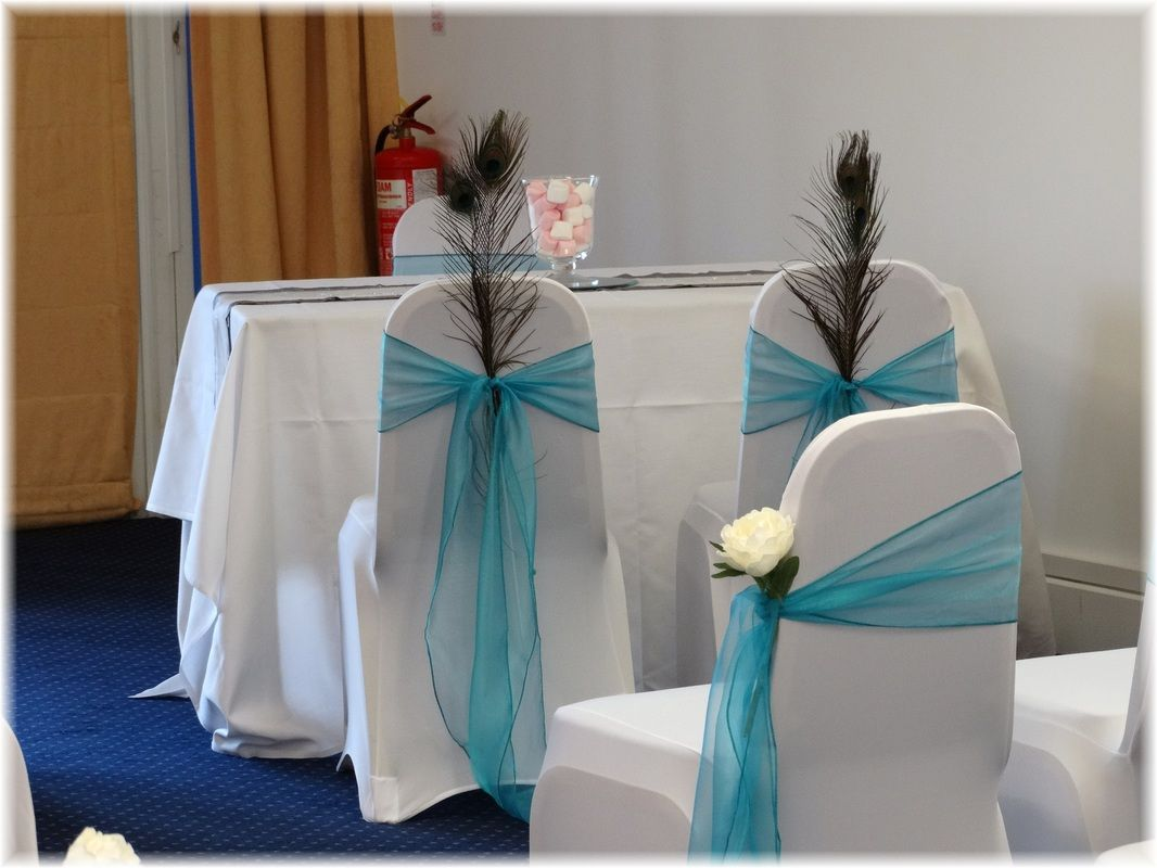 Bride & groom's chairs, pale blue organza sashes with peacock feather detail. Want your own quote? Then email me with your ideas! hello@beckiemelvinevents.co.uk More styles can be seen at www.beckiemelvinevents.co.uk