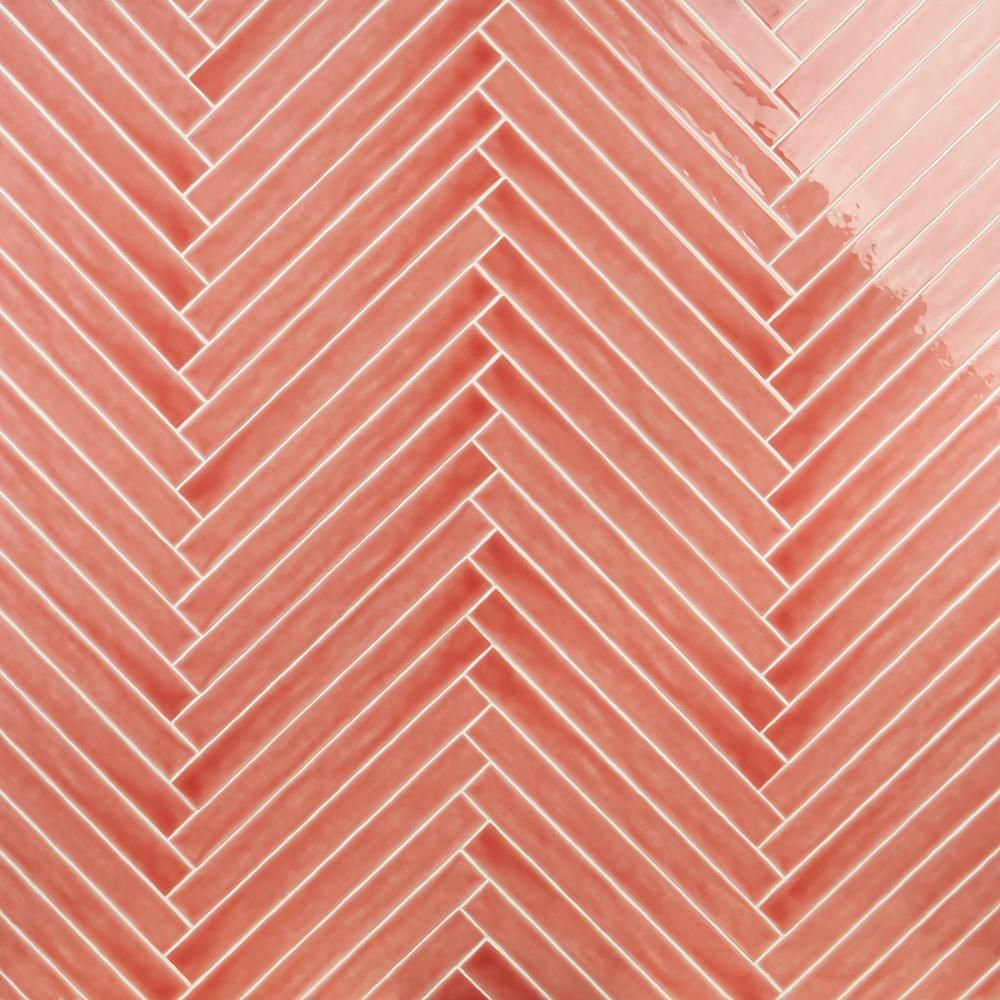 Stylize walls with the Nantucket Coral Ceramic Tile. This deep pink hue is reflective of summer sunsets. With a 2x20 body, it is a twist on traditional subway. The polished body gives it a nice shine, captivating guests. Available in 6 colorways.