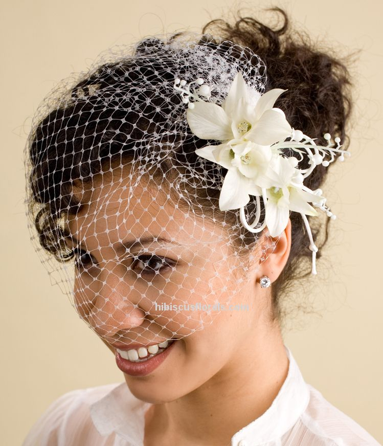 White Birdcage Veil With White Fascinator Of Lilies
