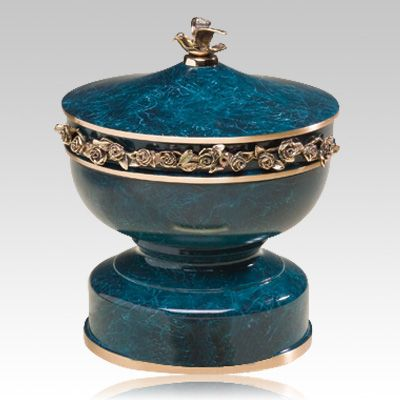 The Bonaire Bronze Cremation Urn is a cast bronze with an aged turquoise verdigris patina and a protective lacquer finished coat; finished to perfection. Highly polished roses on the sides and a wonderful defined dove accent on the top of the urn.  Bottom opening threaded stopper.