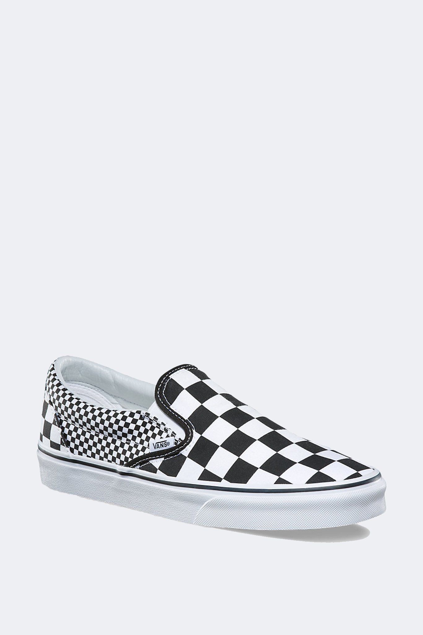 a67b22a588c Classic Slip-on in mix checker from Vans. Sturdy Vans low profile slip-on  canvas uppers with the iconic Vans checkerboard print