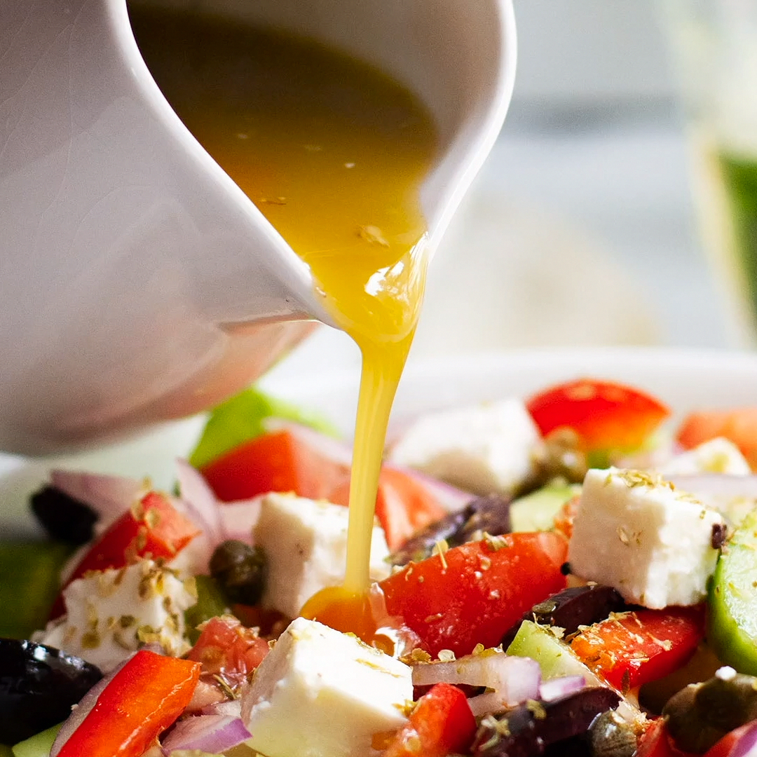 An easy and healthy authentic Greek Salad Dressing recipe made with red wine vinegar and buttery olive oil! It's the best way to dress classic Greek salads and twists on the classic too!