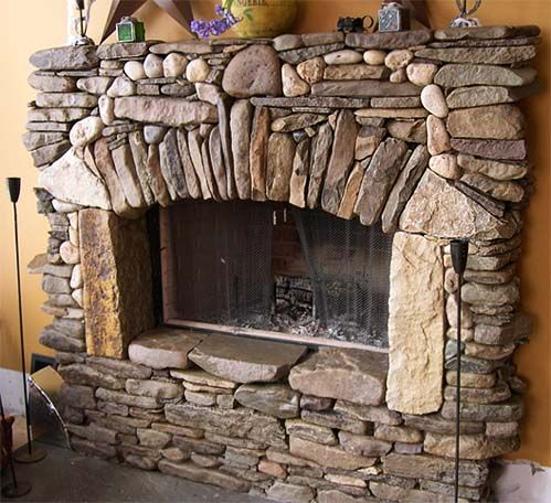 River Stone Fireplace by Stone Angels Masonry