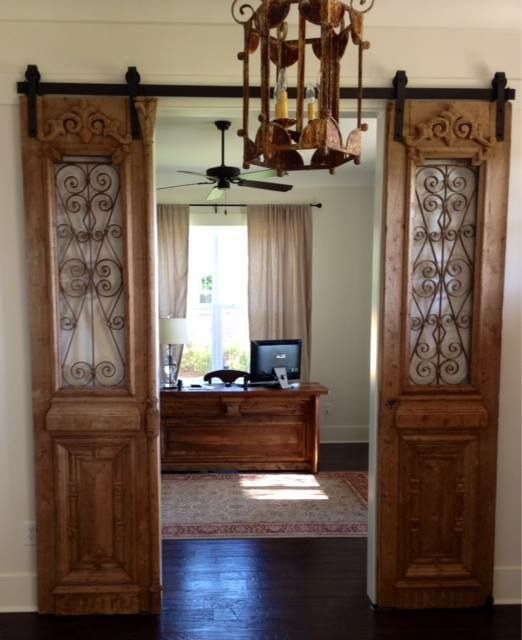 Our antique french iron doors hung barn door style also - How to hang interior french doors ...