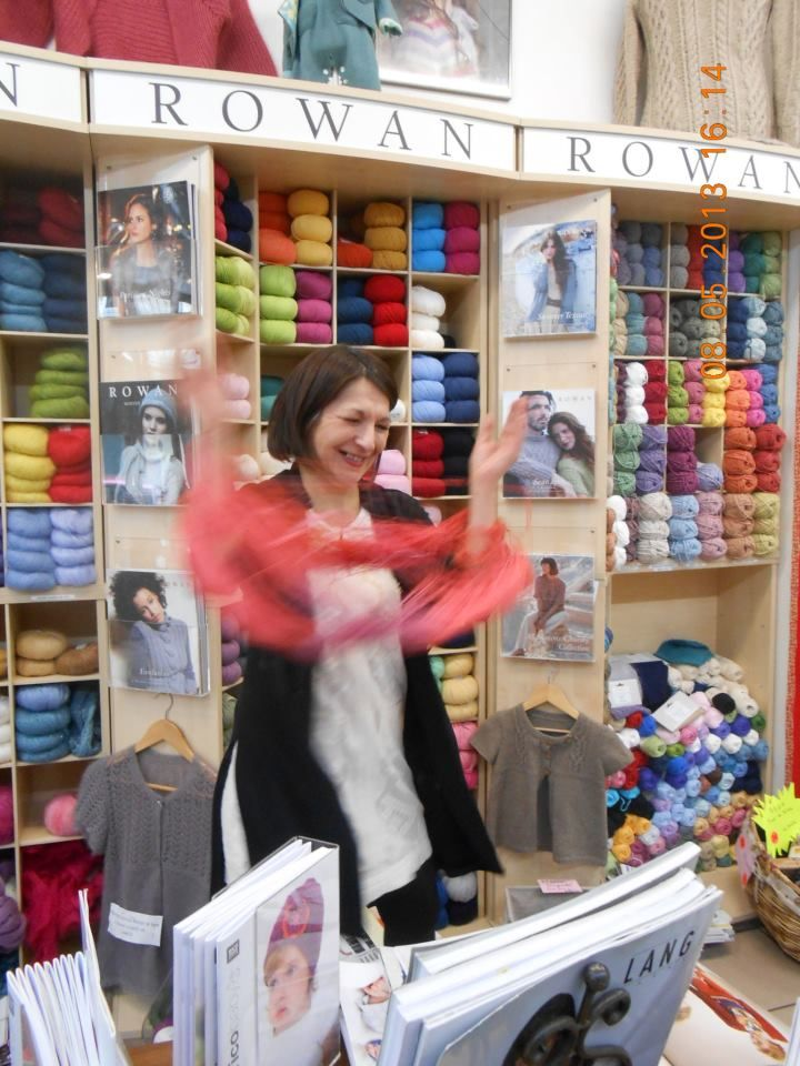 I just love this photo!  Marie is winding a ball of NEW Rowan Fine Art sock/shawl yarn at her store La Lainerie, in Bordeaux, France.  To follow the store on FB, click the photo!