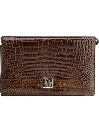 CHRISTIAN DIOR VINTAGE Crocodile Leather Shoulder Bag Brown crocodile leather shoulder bag from Christian Dior Vintage featuring a front flap closure, a gold-tone logo buckle fastening, a shoulder strap and a zip fastening interior compartment.