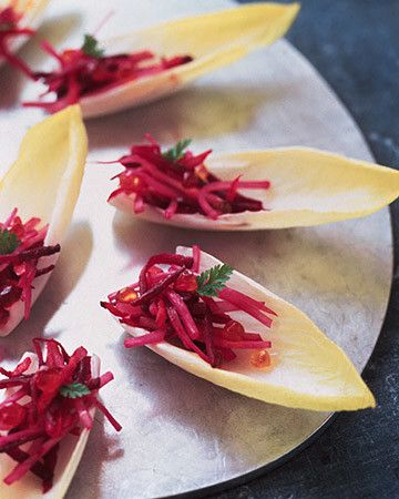 Brightly colored beets, carrots, and fennel are tossed with oil and vinegar and nestled inside fresh endive leaves for a healthy holiday finger food.     Martha Stewart Living, 1996