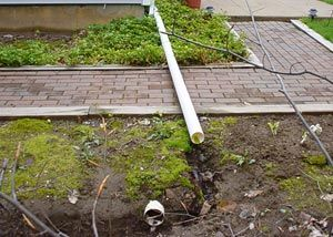 A Gutter Downspout Extension Causing A Serious Problem In The Landscaping And Along A Walkway Gutters Gutter Downspout