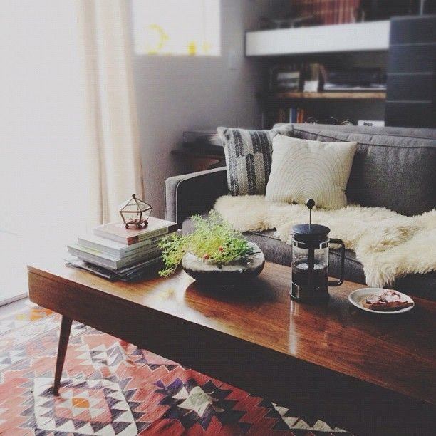 Julia Manchik On Instagram Good To Be Home And Catching Up On Work On The Couch Dark Wood Living Room Living Room Decor Grey Sofa Dark Wood Coffee Table