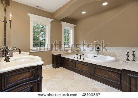 Master Bathroom Dark Cabinets stock photo : master bath in new construction home with dark wood
