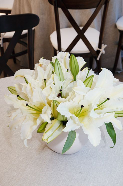 A small yet full centerpiece is complete with white lily