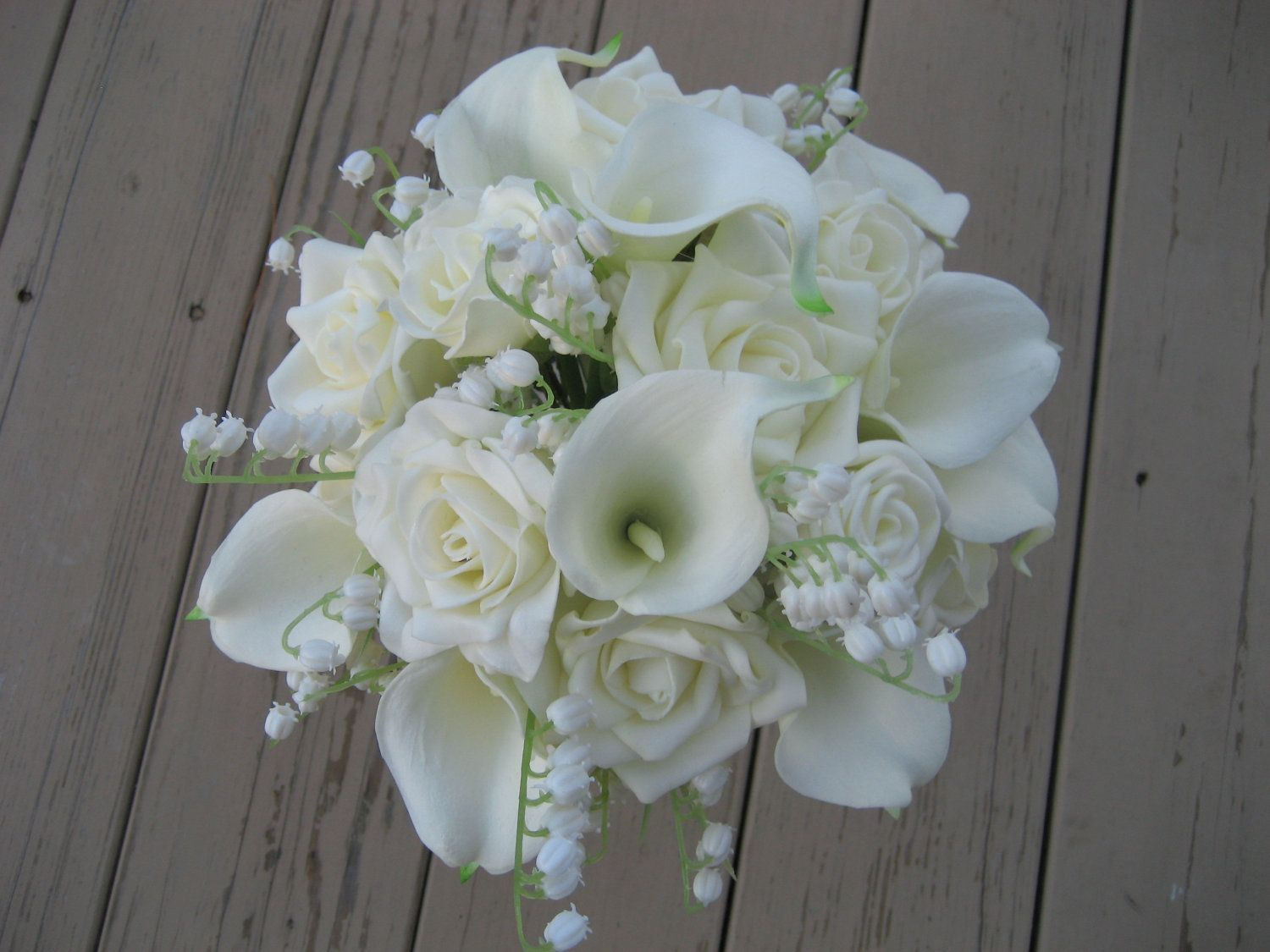All white calla liliy bouquets bouquet all white flowers wedding flower bouquets lily on wedding bouquet all white flowers roses lily of the valley and calla dhlflorist Choice Image