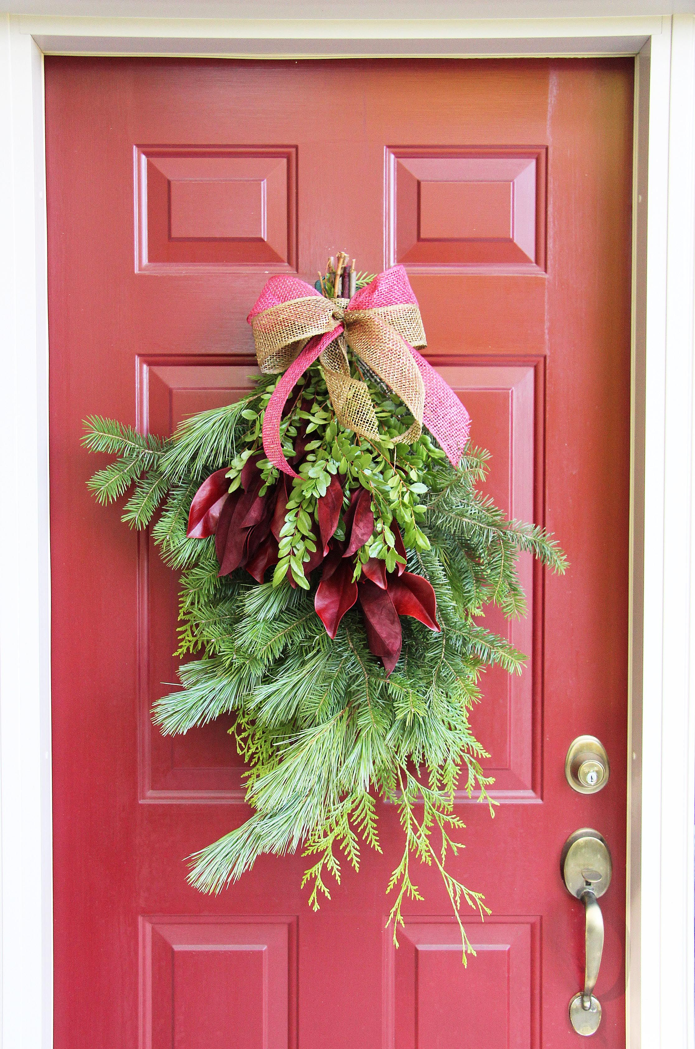 Fresh greens create a beautiful door swag. A great